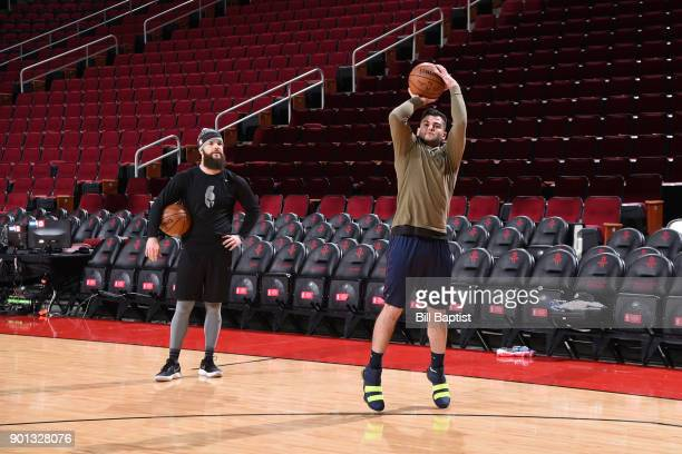Dallas Keuchel and Lance McCullers of the Houston Astros before the game between the Golden State Warriors and the Houston Rockets on January 4 2018...