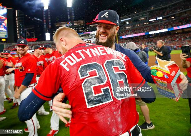 Dallas Keuchel of the Atlanta Braves dunks Mike Foltynewicz of the Atlanta Braves with milk at the conclusion of an MLB game against the San...