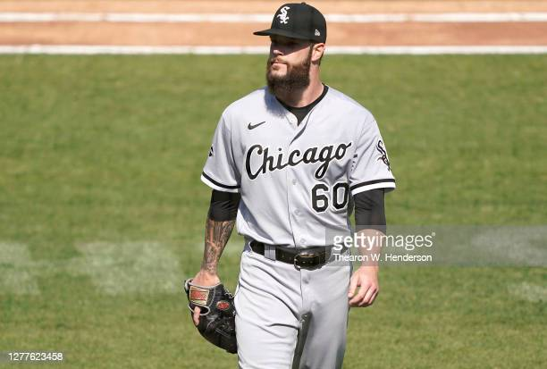 Dallas Keuchel of the Chicago White Sox walks back to the dugout after he was taken out of the game against the Oakland Athletics during the fourth...
