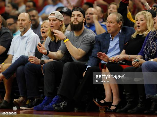 Dallas Keuchel of the Houston Astros and Astros owner Jim Crane watch the first half of the game between the Houston Rockets and the Utah Jazz at...