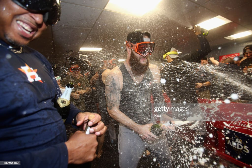 Dallas Keuchel #60 of the Houston Astros celebrates with teammates in the clubhouse after defeating the Boston Red Sox 5-4 in game four of the American League Division Series at Fenway Park on October 9, 2017 in Boston, Massachusetts. The Astros advance to the American League Championship Series.