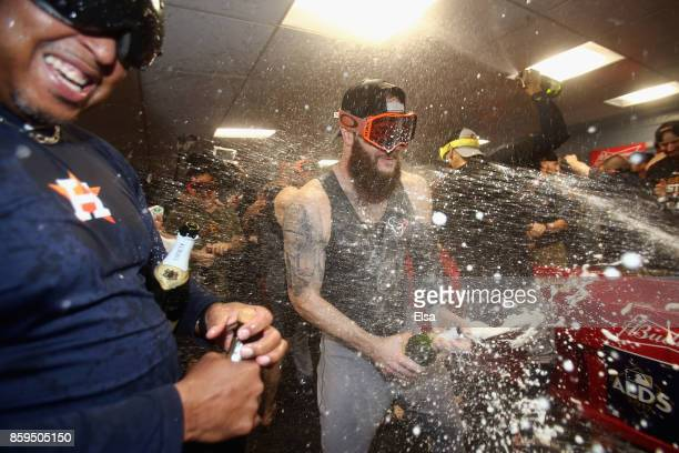 Dallas Keuchel of the Houston Astros celebrates with teammates in the clubhouse after defeating the Boston Red Sox 54 in game four of the American...