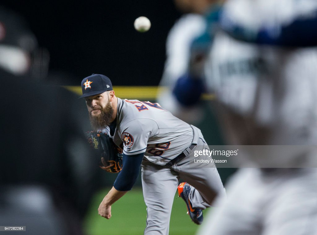 Dallas Keuchel #60 of the Houston Astros delivers against Robinson Cano #22 of the Seattle Mariners in the first inning at Safeco Field on April 16, 2018 in Seattle, Washington.