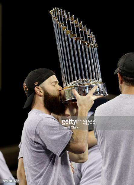 Dallas Keuchel of the Houston Astros kisses the Commissioner's Trophy after defeating the Los Angeles Dodgers 51 in game seven to win the 2017 World...