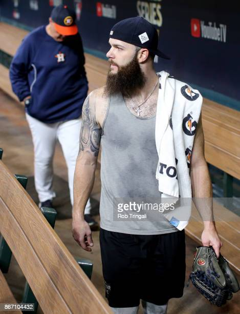 Dallas Keuchel of the Houston Astros looks on from the dugout during the workout day for the 2017 World Series against the Los Angeles Dodgers at...