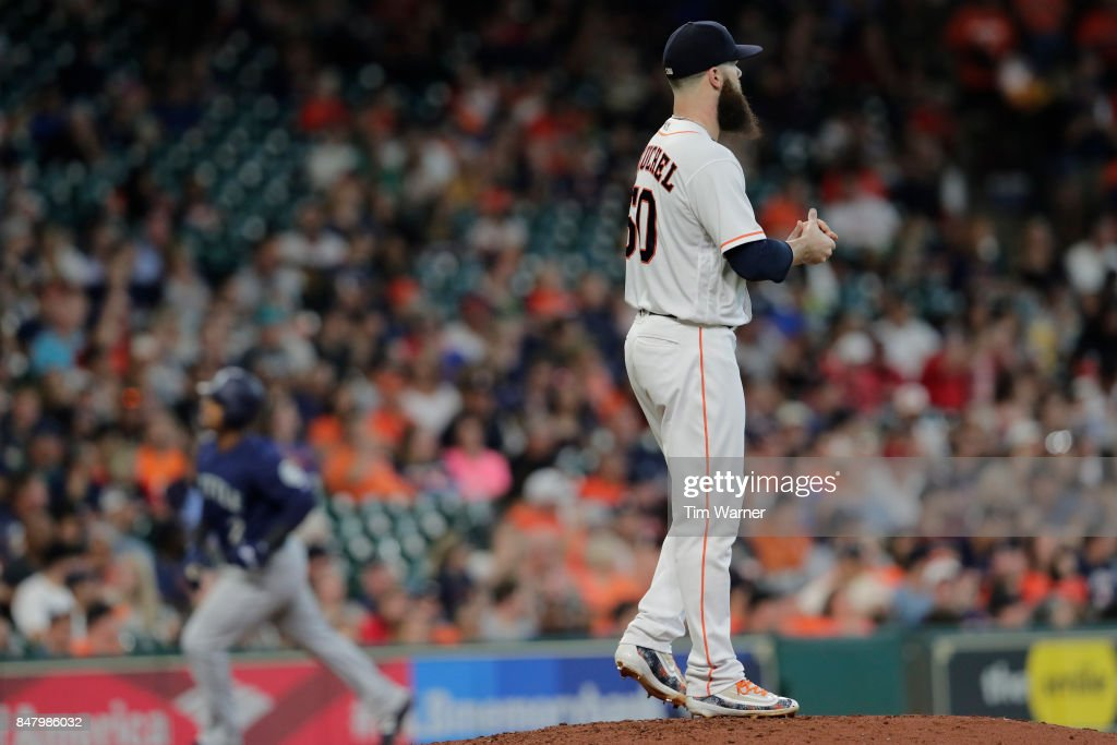 Dallas Keuchel #60 of the Houston Astros reacts on the mound as Jean Segura #2 of the Seattle Mariners rounds the bases after a home run in the sixth inning at Minute Maid Park on September 16, 2017 in Houston, Texas.