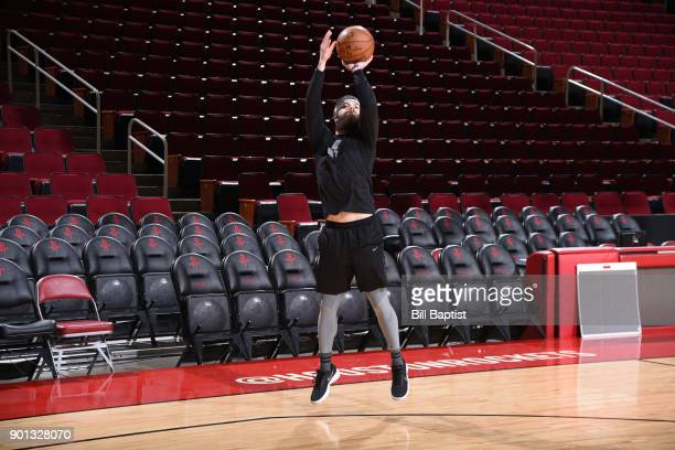 Dallas Keuchel of the Houston Astros shoots around before the game between the Golden State Warriors and the Houston Rockets on January 4 2018 at the...