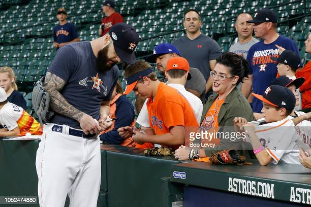 Dallas Keuchel of the Houston Astros signs autographs during batting practice before Game Five of the American League Championship Series against the...