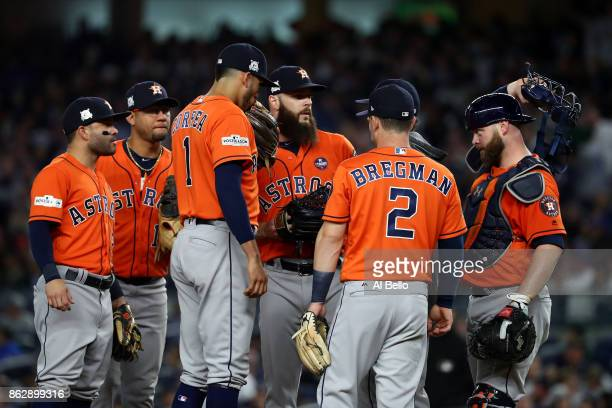 Dallas Keuchel of the Houston Astros speaks to teammates during the fifth inning against the New York Yankees in Game Five of the American League...