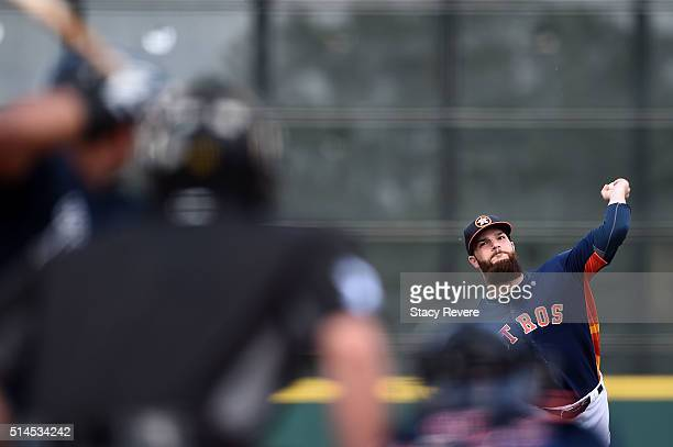 Dallas Keuchel of the Houston Astros throws a pitch during the second inning of a spring training game against the Atlanta Braves at Osceola County...