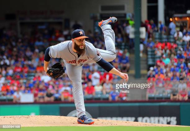 Dallas Keuchel of the Houston Astros throws in the first inning against the Texas Rangers at Globe Life Park in Arlington on August 13 2017 in...