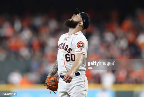 Dallas Keuchel of the Houston Astros watches a fly ball hit by Steve Pearce of the Boston Red Sox in the third inning during Game Three of the...