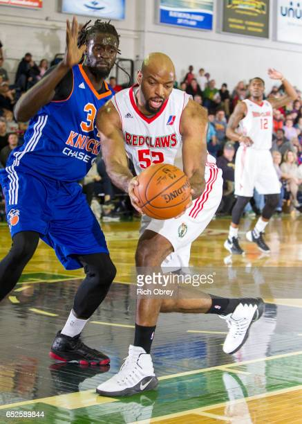 Dallas Lauderdale of the Maine Red Claws grabs a loose ball in from Maurice Ndour of the Westchester Knicks on Sunday March 12 2017 at the Portland...