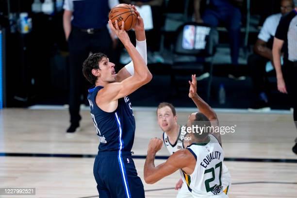 Dallas Mavericks' Boban Marjanovic shoots over Utah Jazz's Rudy Gobert during the first half of an NBA basketball game at The Arena at ESPN Wide...