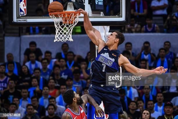 Dallas Mavericks' Canadian Dwight Powell dunks during the preseason NBA basketball game between Dallas Mavericks and Philadelphia 76ers in Shenzhen...