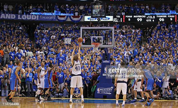Dallas Mavericks' Dirk Nowitzki converts a free throw for the game's final point with 133 seconds to play in a 10096 victory over the Oklahoma City...