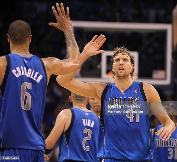 Dallas Mavericks' Dirk Nowitzki highfives teammate Tyson Chandler in the final seconds of the game against the Oklahoma City Thunder in Game 3 of the...