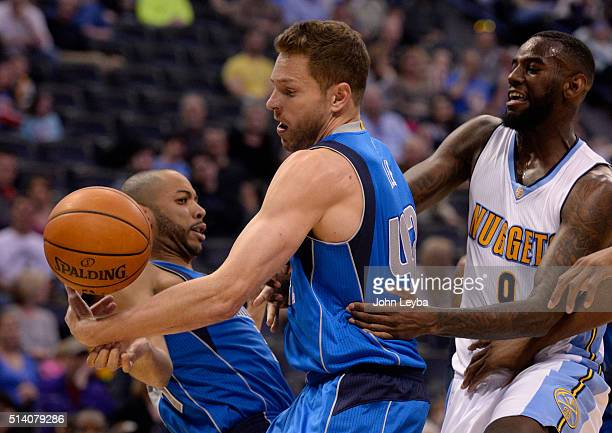 Dallas Mavericks forward David Lee pulls down a rebound from Denver Nuggets guard JaKarr Sampson during the first quarter March 6 2016 at Pepsi Center