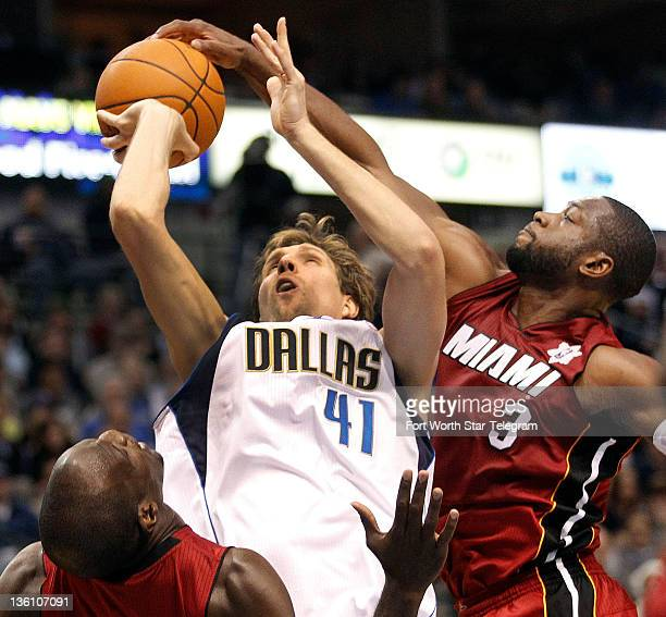Dallas Mavericks forward Dirk Nowitzki has his shot blocked by Miami Heat guard Dwyane Wade as Heat center Joel Anthony helps out during the first...