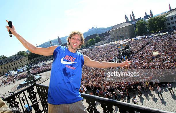Dallas Mavericks forward Dirk Nowitzki poses on the balcony of the Wuerzburg Residence on June 28 2011 in Wuerzburg Germany Nowitzki visits his...