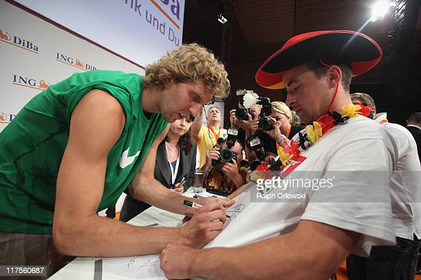 Dallas Mavericks forward Dirk Nowitzki signs autographs at the sOliver Arena on June 28 2011 in Wuerzburg Germany Nowitzki visits his hometown...