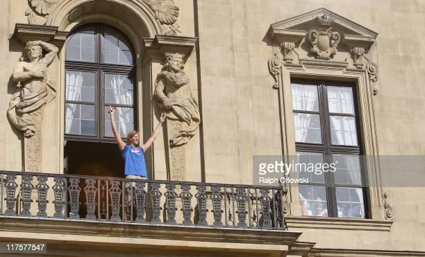 Dallas Mavericks forward Dirk Nowitzki waves on the balcony of the Wuerzburg Residence on June 28 2011 in Wuerzburg Germany Nowitzki visits his...