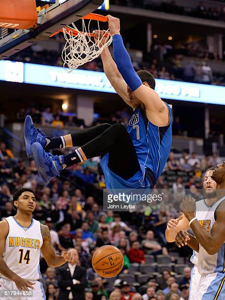 Dallas Mavericks forward Dwight Powell slams a big dunk against the Denver Nuggets during the fourth quarter March 28 2016 at Pepsi Center
