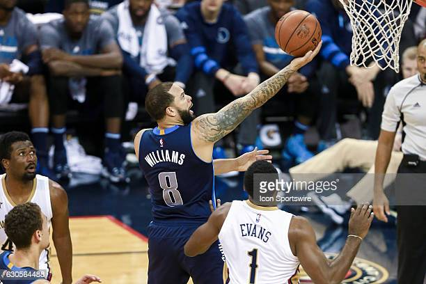 Dallas Mavericks guard Deron Williams drives to the basket against New Orleans Pelicans guard Tyreke Evans during the game between the New Orleans...