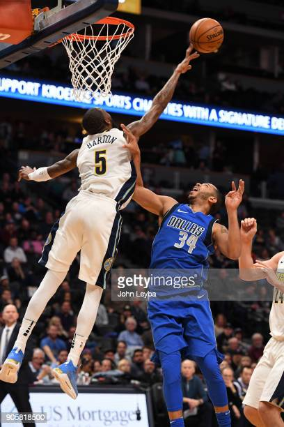 Dallas Mavericks guard Devin Harris gets his shot blocked by Denver Nuggets guard Will Barton during the fourth quarter on January 16 2018 at Pepsi...