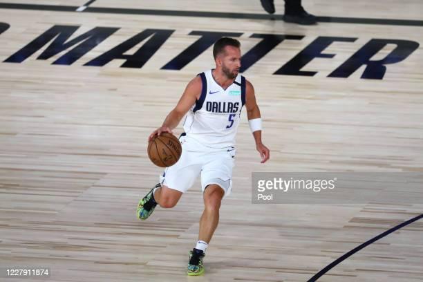 Dallas Mavericks guard J.J. Barea brings the ball upcourt against the Sacramento Kings during the first half of an NBA basketball game at HP Field...