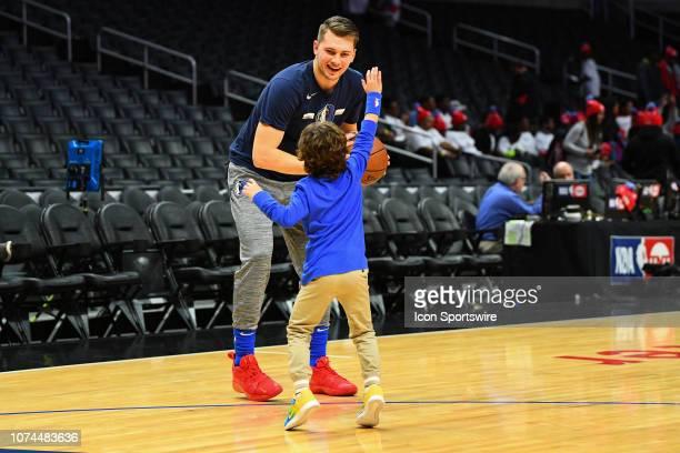 Dallas Mavericks Guard Luka Doncic plays with Dallas Mavericks Guard JJ Barea's son before a NBA game between the Dallas Mavericks and the Los...