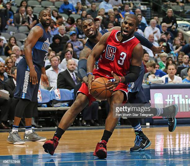 Dallas Mavericks guard Wesley Matthews drives in to try and block a shot by Los Angeles Clippers guard Chris Paul during the third quarter on...