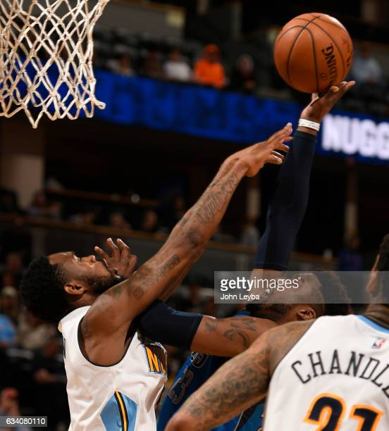 Dallas Mavericks guard Wesley Matthews gets fouled by Denver Nuggets guard Will Barton during the fourth quarter February 6 2017 at Pepsi Center