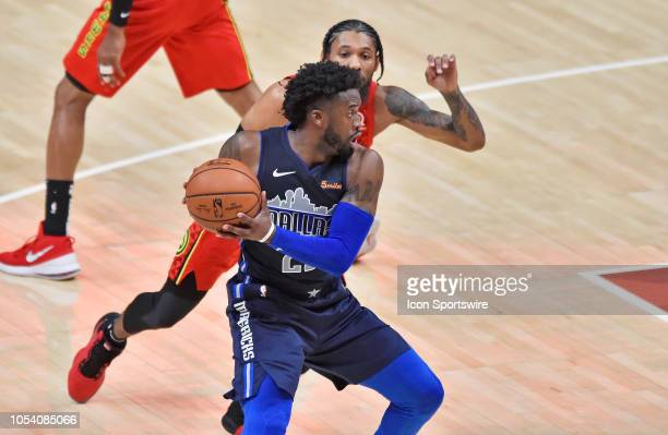 Dallas Mavericks guard Wesley Matthews looks to get around an Atlanta Hawks defender during the second quarter of a NBA game on October 24 at State...