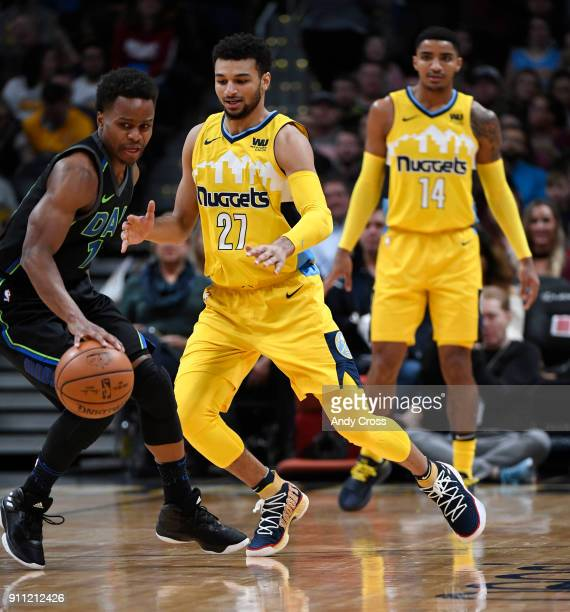 Dallas Mavericks guard Yogi Ferrell dribbles around Denver Nuggets guard Jamal Murray in the first half at the Pepsi Center January 27 2018