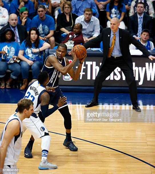 Dallas Mavericks head coach Rick Carlisle uses body language as he watches guard Wesley Matthews defend the Oklahoma City Thunder's Kevin Durant in...