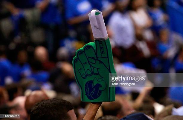 Dallas Mavericks holds up a foam finder with a splint on the index finger before the start of Game Three of the 2011 NBA Finals at American Airlines...