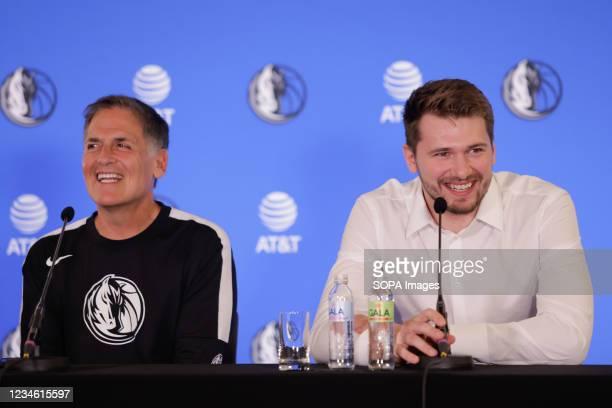 Dallas Mavericks owner Mark Cuban and Luka Doncic speak at a press conference. Slovenian NBA star, Luka Doncic signed a five-year 207-million-dollar...