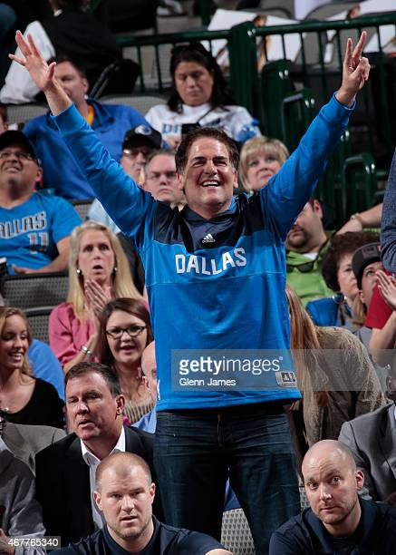 Dallas Mavericks owner Mark Cuban celebrates during a game against the Orlando Magic on March 18 2015 at the American Airlines Center in Dallas Texas...