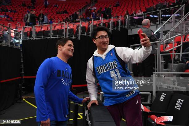 Dallas Mavericks owner Mark Cuban poses for a photo with a fan prior to the game against the Detroit Pistons on April 6 2018 at Little Caesars Arena...