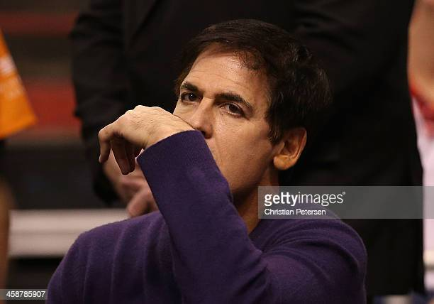 Dallas Mavericks owner Mark Cuban reacts during the NBA game against the Phoenix Suns at US Airways Center on December 21 2013 in Phoenix Arizona The...