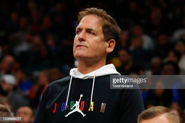 Dallas Mavericks owner Mark Cuban watches on from behind the bench during the second half of an NBA game against the Atlanta Hawks at State Farm...