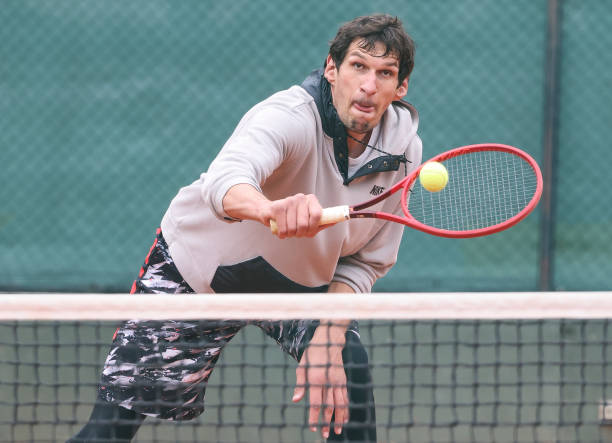 SRB: Boban Marjanovic Plays A Tennis Match