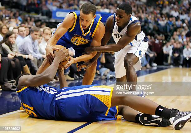 Dallas Mavericks point guard Darren Collison battles Golden State Warriors shooting guard Stephen Curry and center Festus Ezeli for control of the...