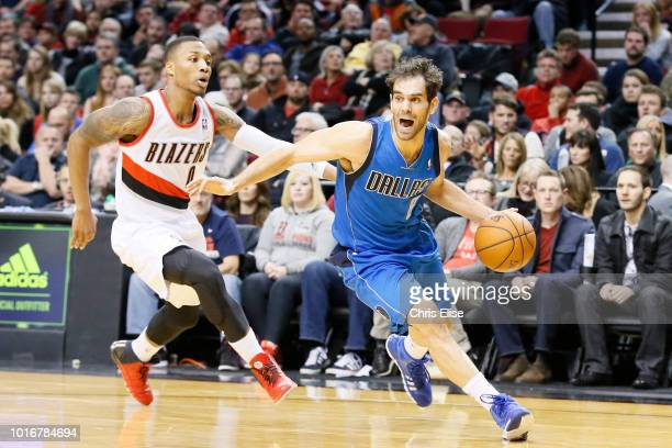 Dallas Mavericks point guard Jose Calderon drives past Portland Trail Blazers point guard Damian Lillard during the Dallas Mavericks 108106 victory...
