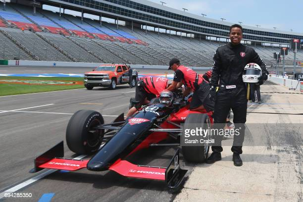 Dallas Mavericks point guard Yogi Ferrell poses prior to riding in a twoseat IndyCar with racing legend Mario Andretti following practice for the...