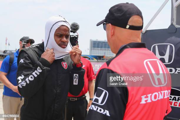 Dallas Mavericks point guard Yogi Ferrell prepares to ride in a twoseat IndyCar with racing legend Mario Andretti following practice for the Verizon...