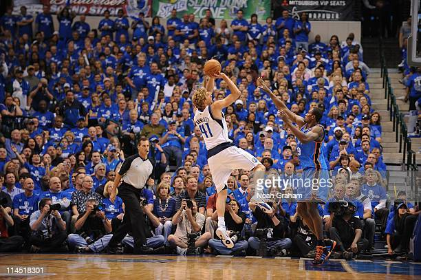 Dallas Mavericks power forward Dirk Nowitzki goes for a jump shot during a play against the Oklahoma City Thunder during Game Two of the Western...