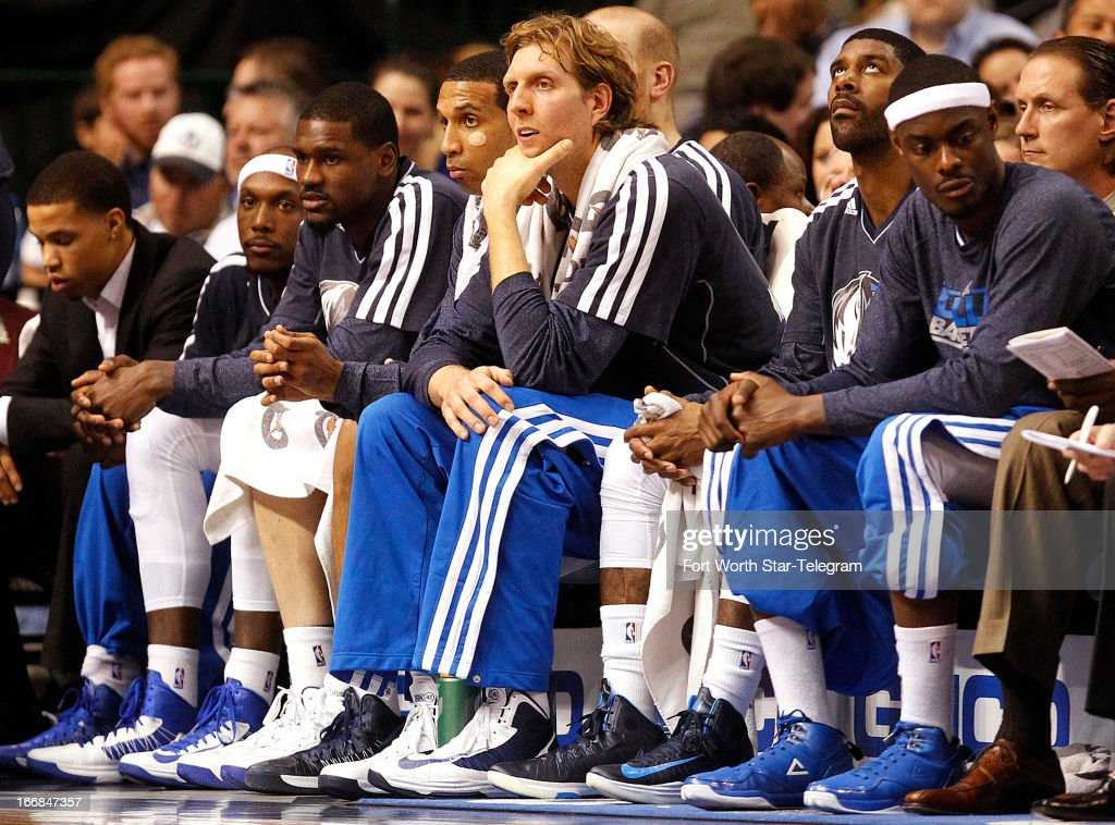 Dallas Mavericks power forward Dirk Nowitzki, middle, and his teammates watch the action during an NBA game against the New Orleans Hornets on Wednesday April 17, 2013, in Dallas, Texas.