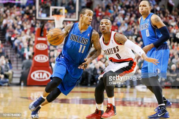 Dallas Mavericks shooting guard Monta Ellis drives past Portland Trail Blazers point guard Damian Lillard during the Dallas Mavericks 108106 victory...